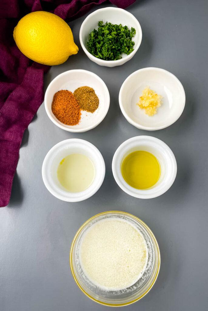 fresh lemon, fresh parsley, Cajun Seasoning, Old Bay Seasoning, minced garlic, melted butter, and olive oil in separate bowls