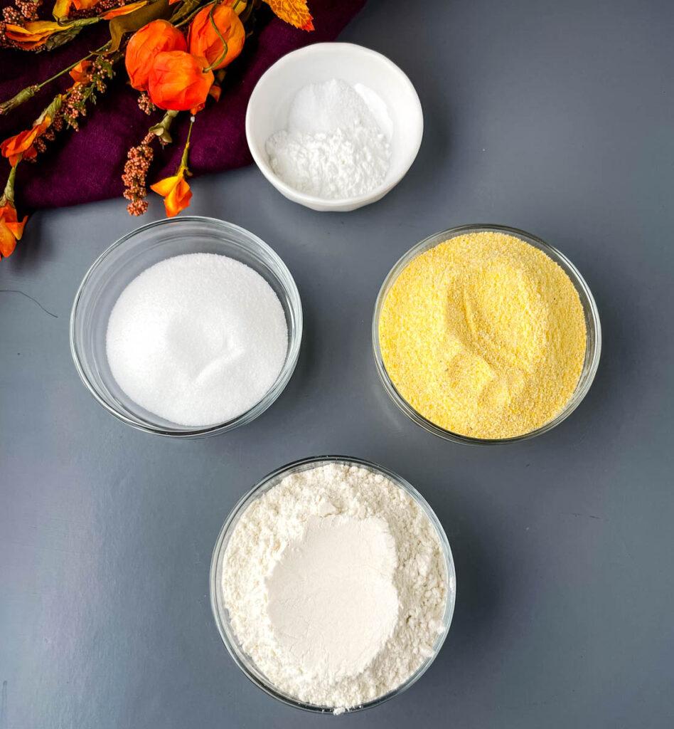 cornmeal, flour, baking powder, sweetener, and salt in separate glass bowls