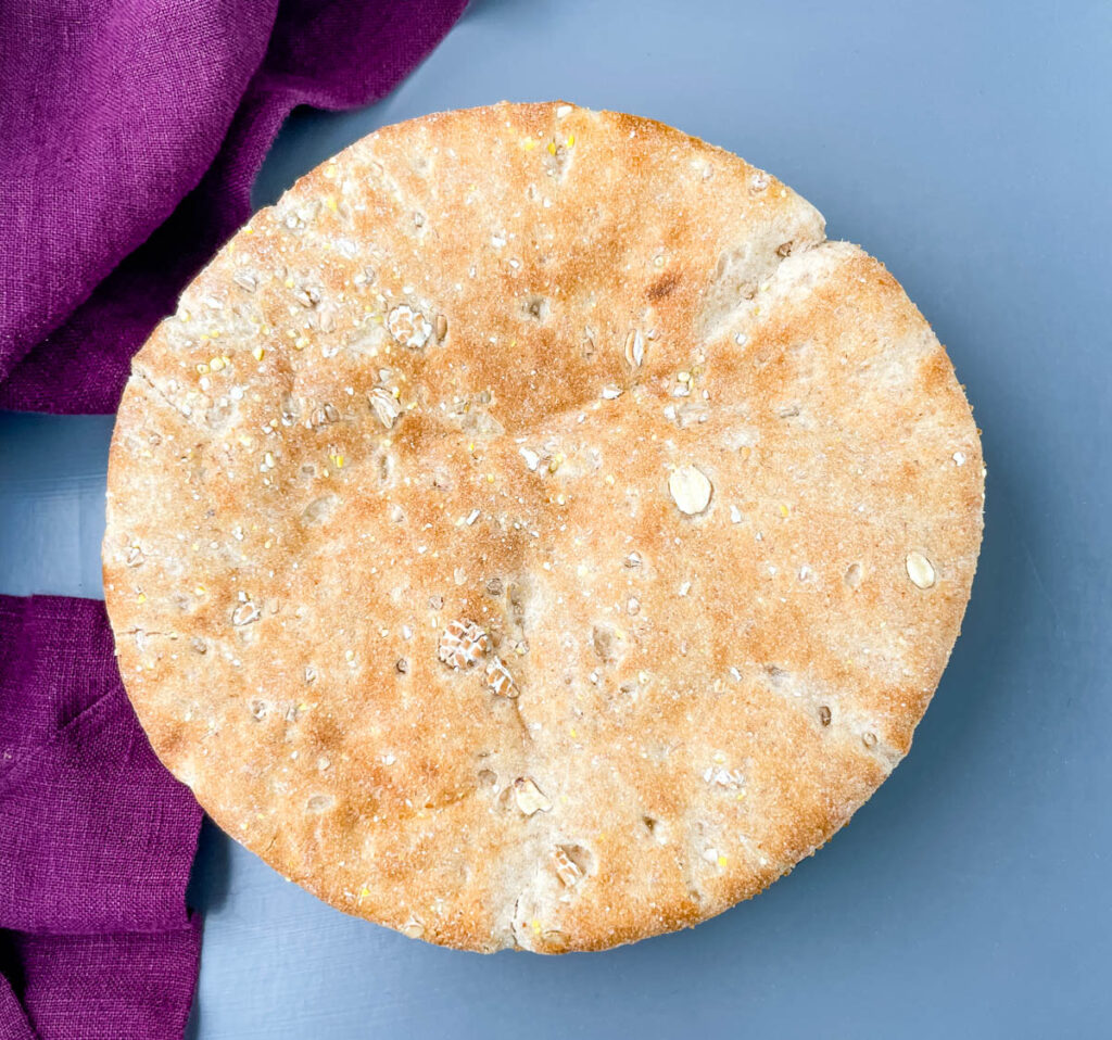 whole wheat pita bread on a flat surface