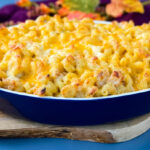 seafood shrimp and crab mac and cheese in a blue baking dish