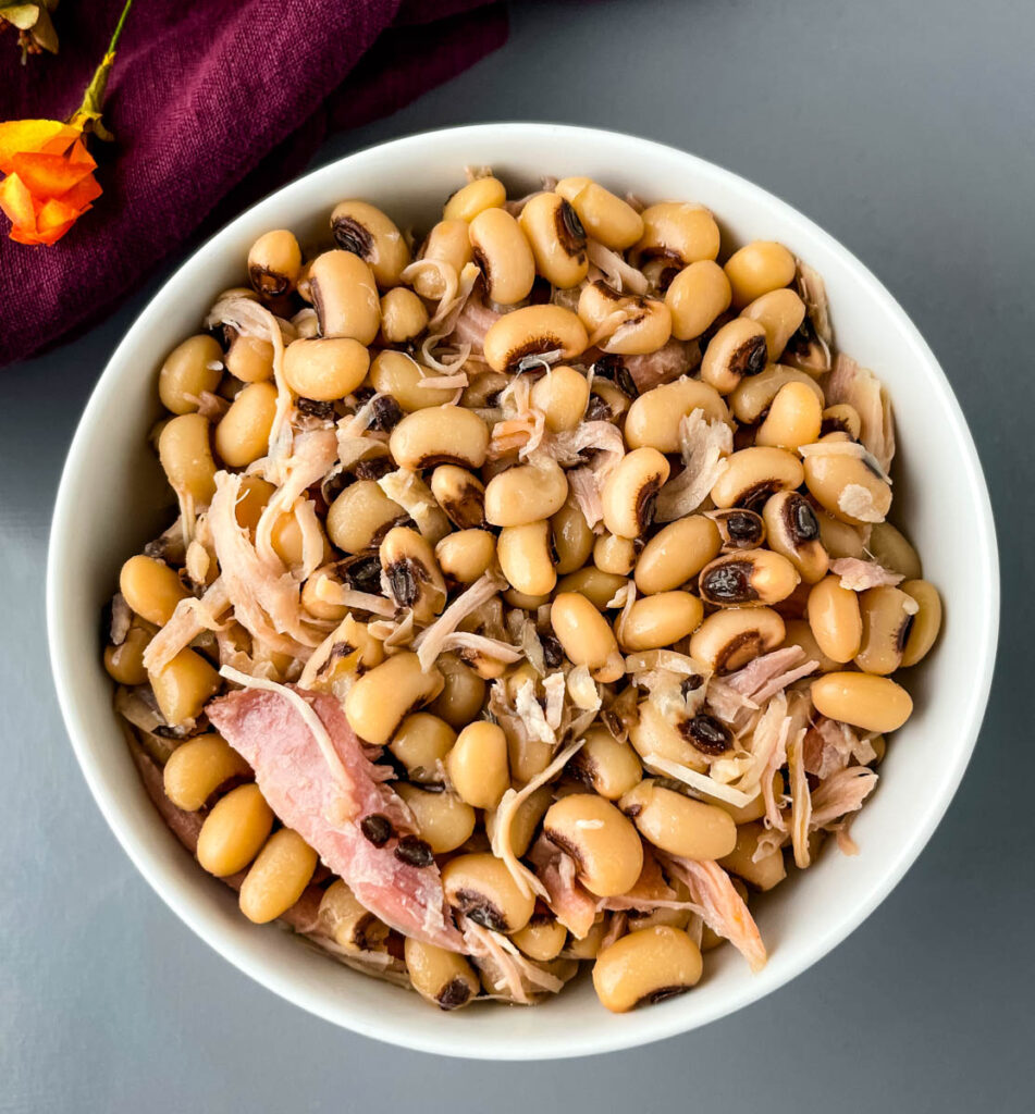 black eyed peas in a white bowl with smoked turkey