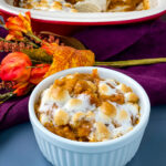sweet potato casserole with marshmallows in a white dish