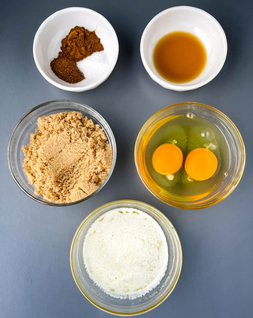 vanilla, spices. sugar, eggs, and sweetener in separate bowls