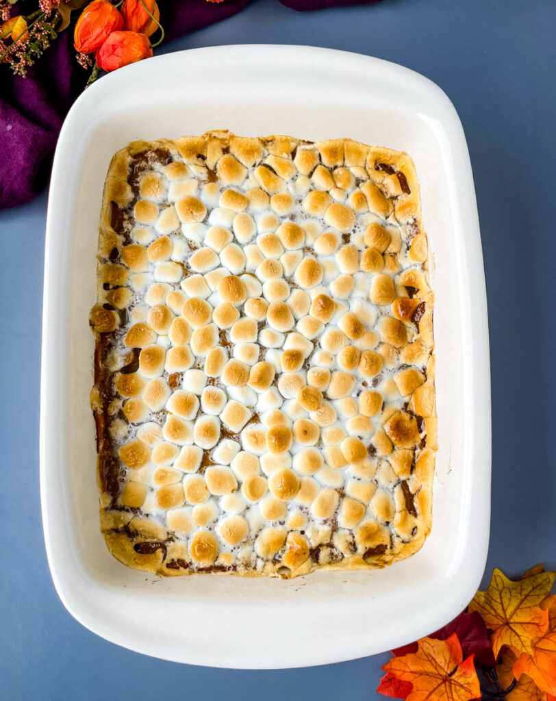 sweet potato casserole with marshmallows in a red baking dish