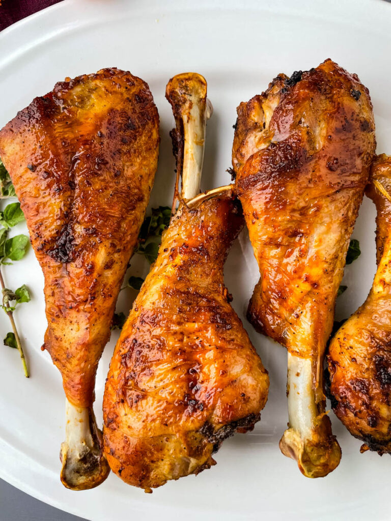 air fryer turkey legs on a white plate