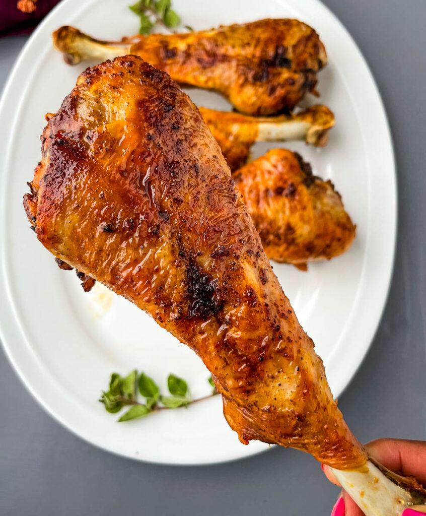 person holding an air fryer turkey leg