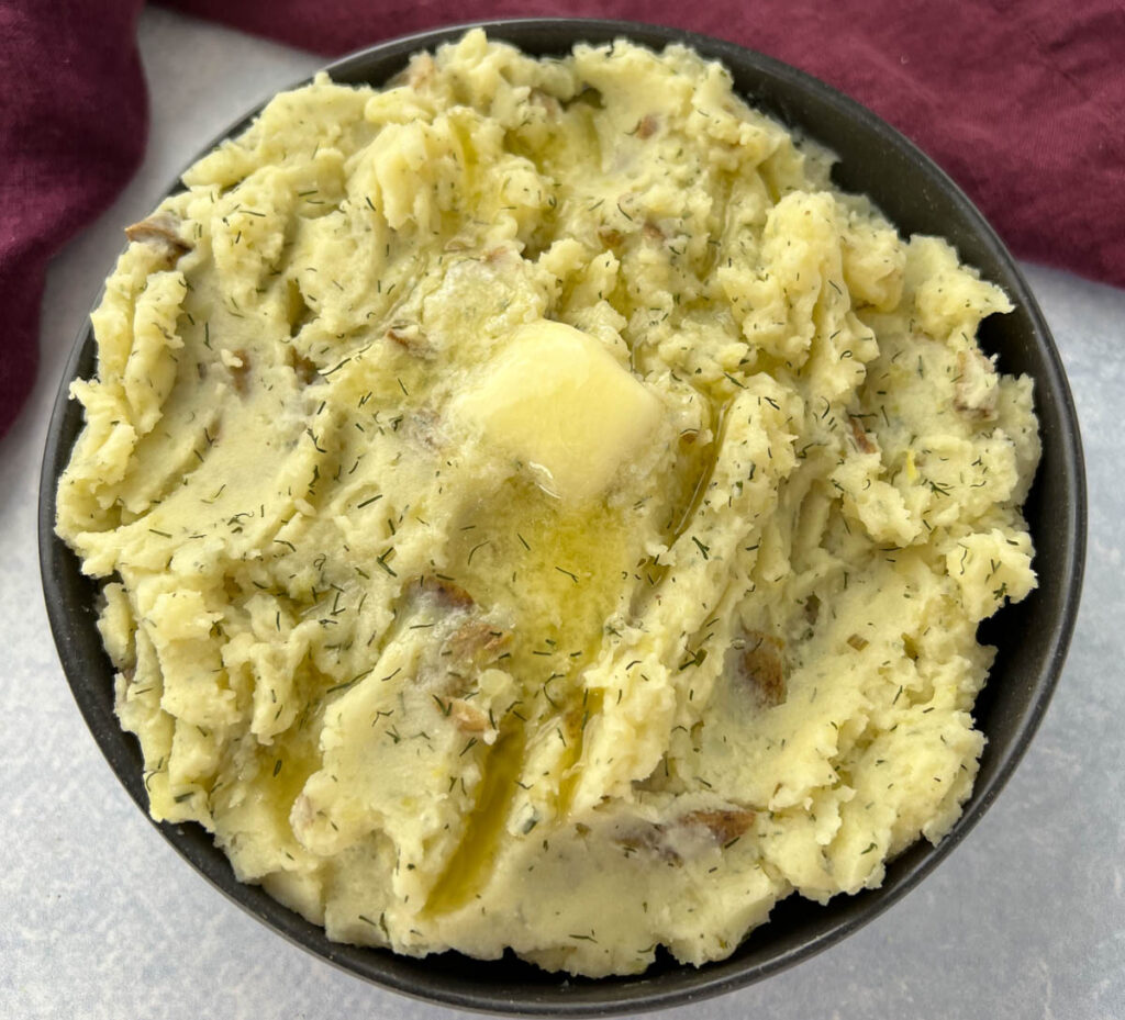 ranch mashed potatoes in a bowl with butter