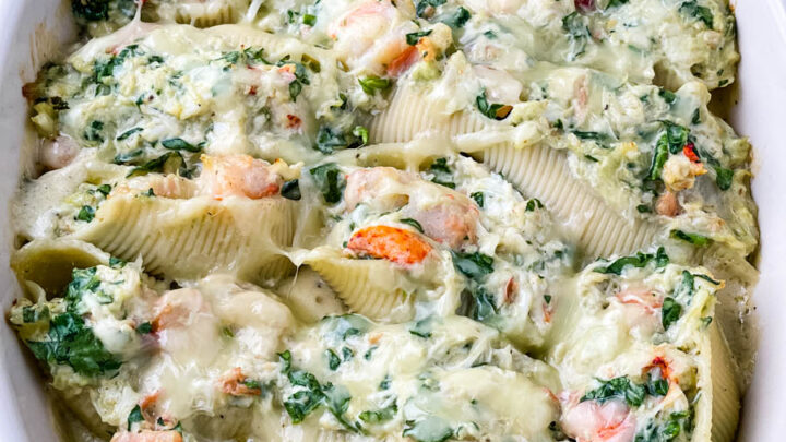seafood lobster, shrimp, and crab stuffed shells in a baking dish