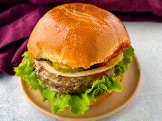 air fryer cheeseburger on a plate