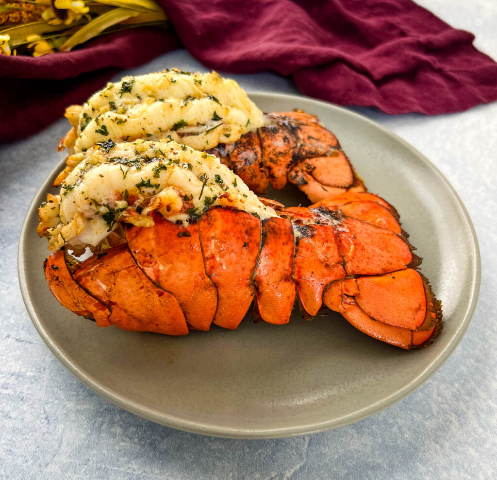 air fryer lobster tails on a white plate
