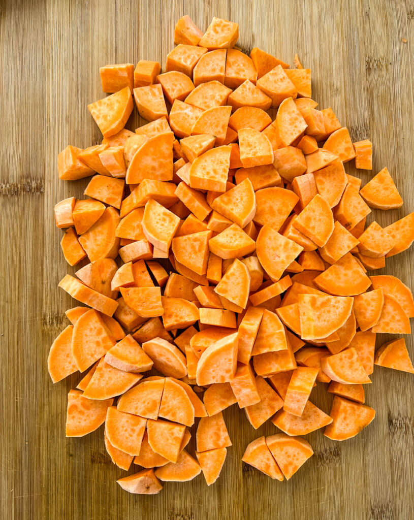 sliced and cut sweet potatoes on a cutting board